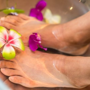 person's feet with flowers